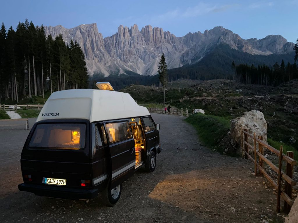 van in front of dolomites at night
