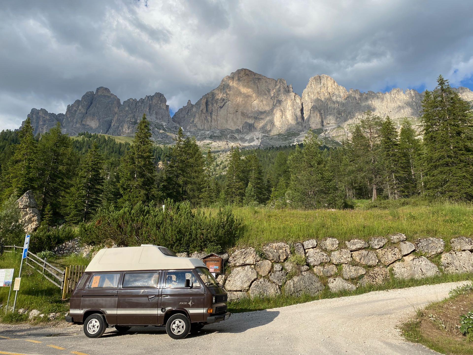 Van in front of Dolomites